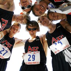 American Fork team huddles after winning the boys 5A state cross country high school championship at Sugarhouse Park in Salt Lake City, Wednesday, Oct. 19, 2011.