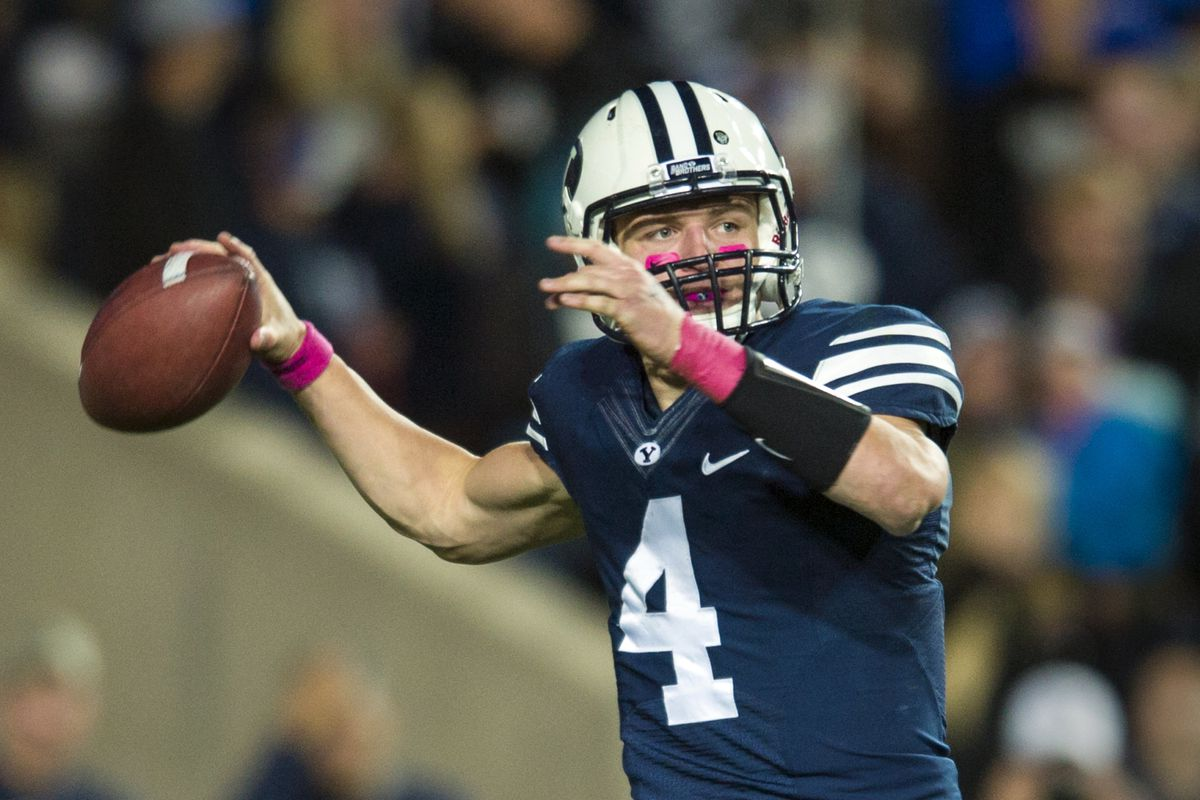 Taysom Hill looks to pass