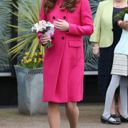 Leaving London's Stephen Lawrence Centre on March 27th, 2015 in a fuchsia Mulberry coat.