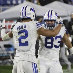Brigham Young Cougars wide receiver Neil Pau'u (2) celebrates his touchdown against the UCF Knights with Brigham Young Cougars tight end Isaac Rex (83) during the Boca Raton Bowl in Boca Raton, Fla., on Tuesday, Dec. 22, 2020.