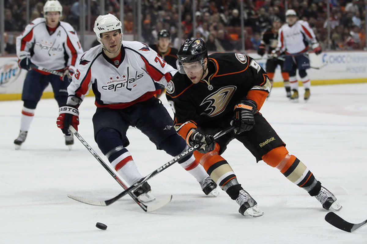 ANAHEIM CA - FEBRUARY 16:  Bobby Ryan #9 of the Anaheim Ducks is pursued by Dave Hannan #23 of the Washington Capitals in the first period at the Honda Center on February 16 2011 in Anaheim California.  (Photo by Jeff Gross/Getty Images)