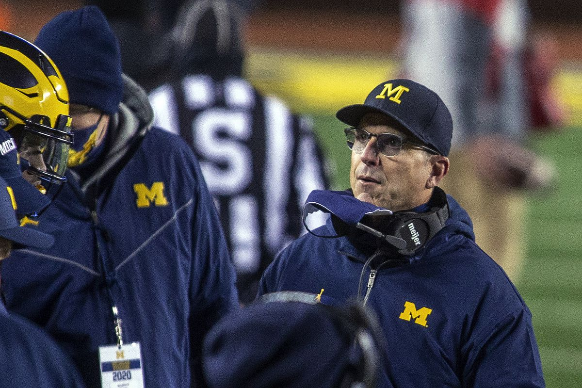 Michigan football coach Jim Harbaugh has agreed to a new five-year contract with the school.