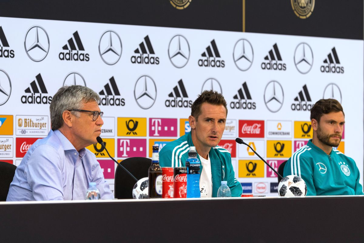 EPPAN, ITALY - JUNE 07: Miroslav Klose (C) talks to the media during the final press conference at the DFB media center on June 7, 2018 in Eppan, Italy.
