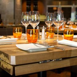 Tables custom made of local wood, varying types.