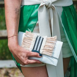 Raffia detail on her clutch confirm that yes, it is indeed summer.