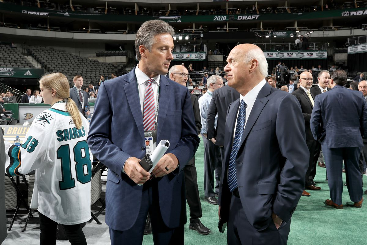 DALLAS, TX - JUNE 22: (l-r) Doug Wilson of the San Jose Sharks and Lou Lamoriello of the New York Islanders chat prior to the first round of the 2018 NHL Draft at American Airlines Center on June 22, 2018 in Dallas, Texas.