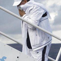 Abdel Baset al-Megrahi boards an airplane in Glasgow, Scotland, on Aug. 20.