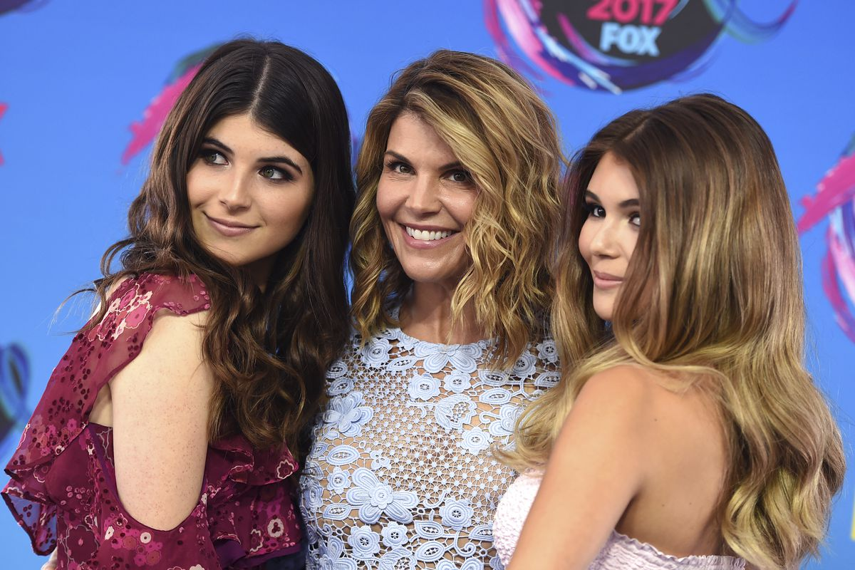 Bella Loughlin, from left, Lori Loughlin, and Olivia Loughlin arrive at the Teen Choice Awards at the Galen Center on Sunday, Aug. 13, 2017, in Los Angeles.