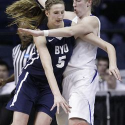 DePaul forward Katherine Harry, right, guards BYU center Jennifer Hamson (5) during the second half of an NCAA tournament first-round women's college basketball game in Rosemont, Ill., Saturday, March 17, 2012. DePaul won 59-55. (AP Photo/Nam Y. Huh)