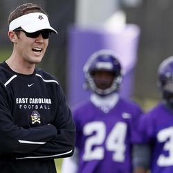 In this Wednesday, April 11, 2012 photo,  East Carolina offensive coordinator for quarterback Lincoln Riley coaches during football practice in Greenville, N.C. With Dominique Davis gone, East Carolina has an open race for its starting quarterback job.