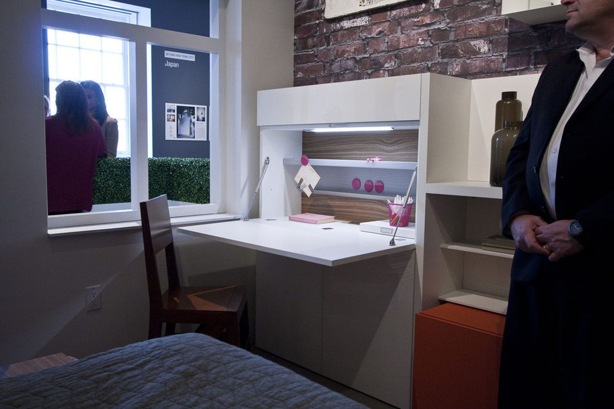 Inside the micro-apartment within the exhibit, a fold-away desk.