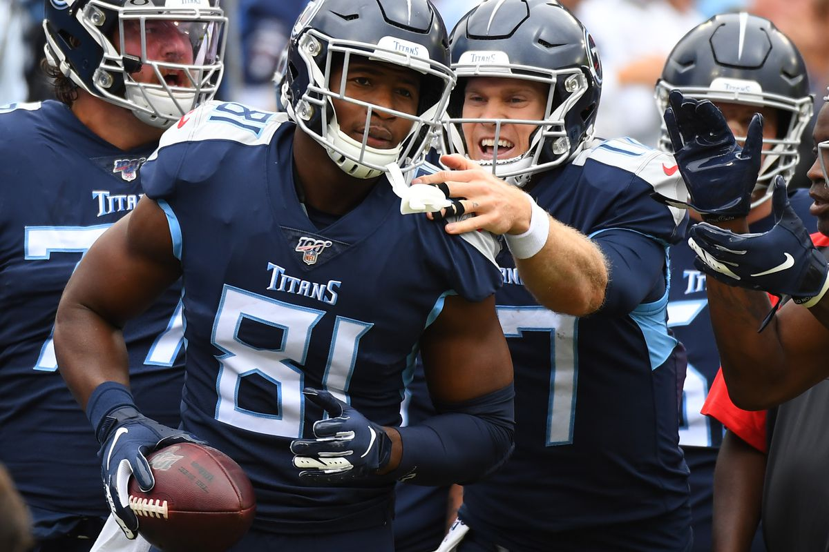 Tennessee Titans tight end Jonnu Smith celebrates with quarterback Ryan Tannehill after a touchdown during the first half against the Tampa Bay Buccaneers at Nissan Stadium.