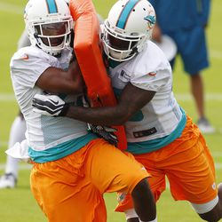 Jul 22, 2013; Davie, FL, USA;  Miami Dolphins defensive back De'Andre Presley (left) and Miami Dolphins cornerback Jamar Taylor (right) work on tackling during  training camp at the Doctors Hospital Training Facility at Nova Southeastern University.