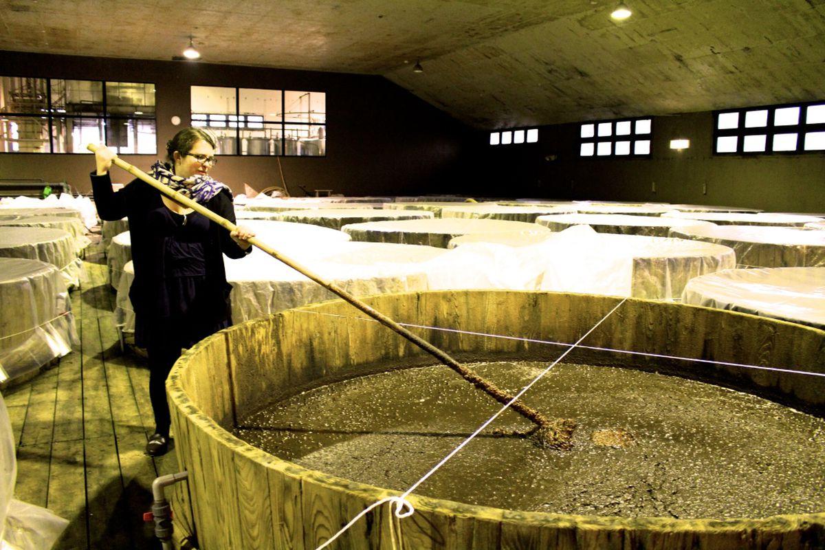 Arielle Johnson stirs a vat of soy sauce in Saitama, Japan