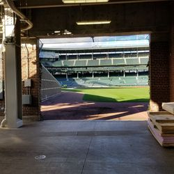 Right field gate open, showing construction material and field