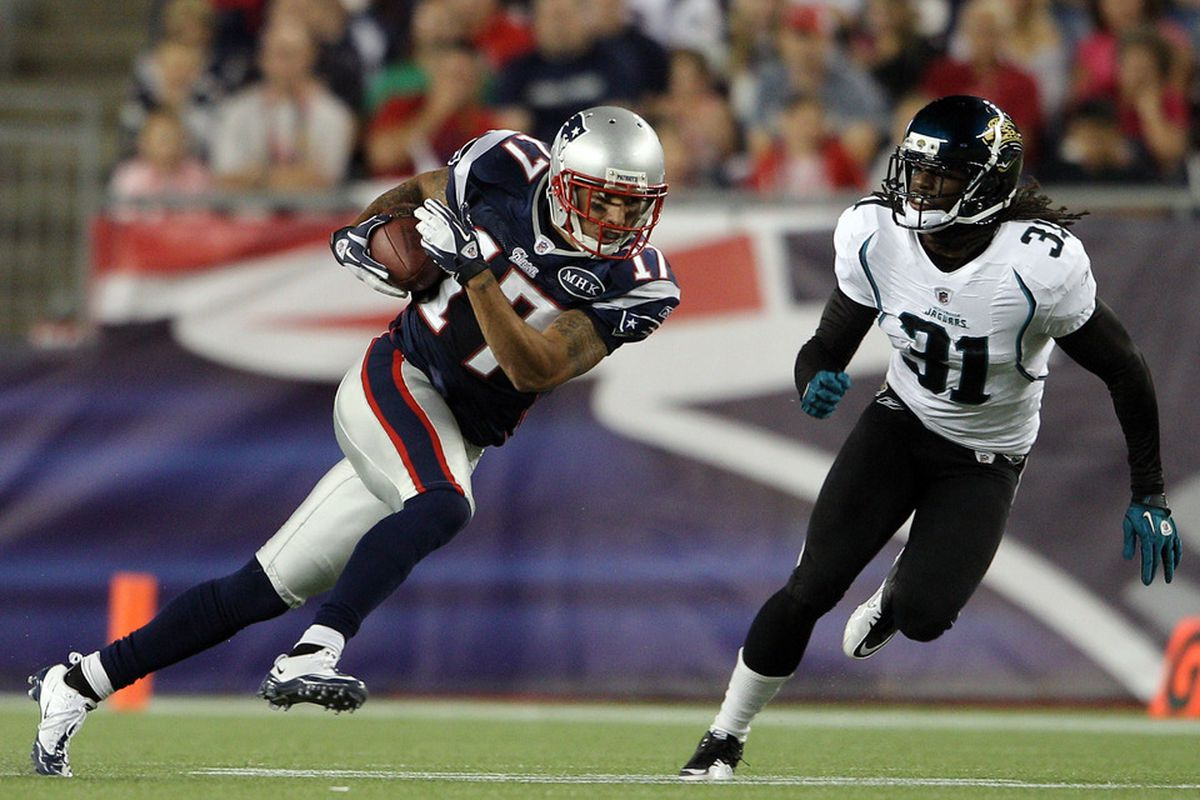 FOXBORO, MA - AUGUST 11:  Taylor Price #17 of the New England Patriots carries the ball as David Jones #31 of the Jacksonville Jaguars defends on August 11, 2011 at Gillette Stadium in Foxboro, Massachusetts.  (Photo by Elsa/Getty Images)