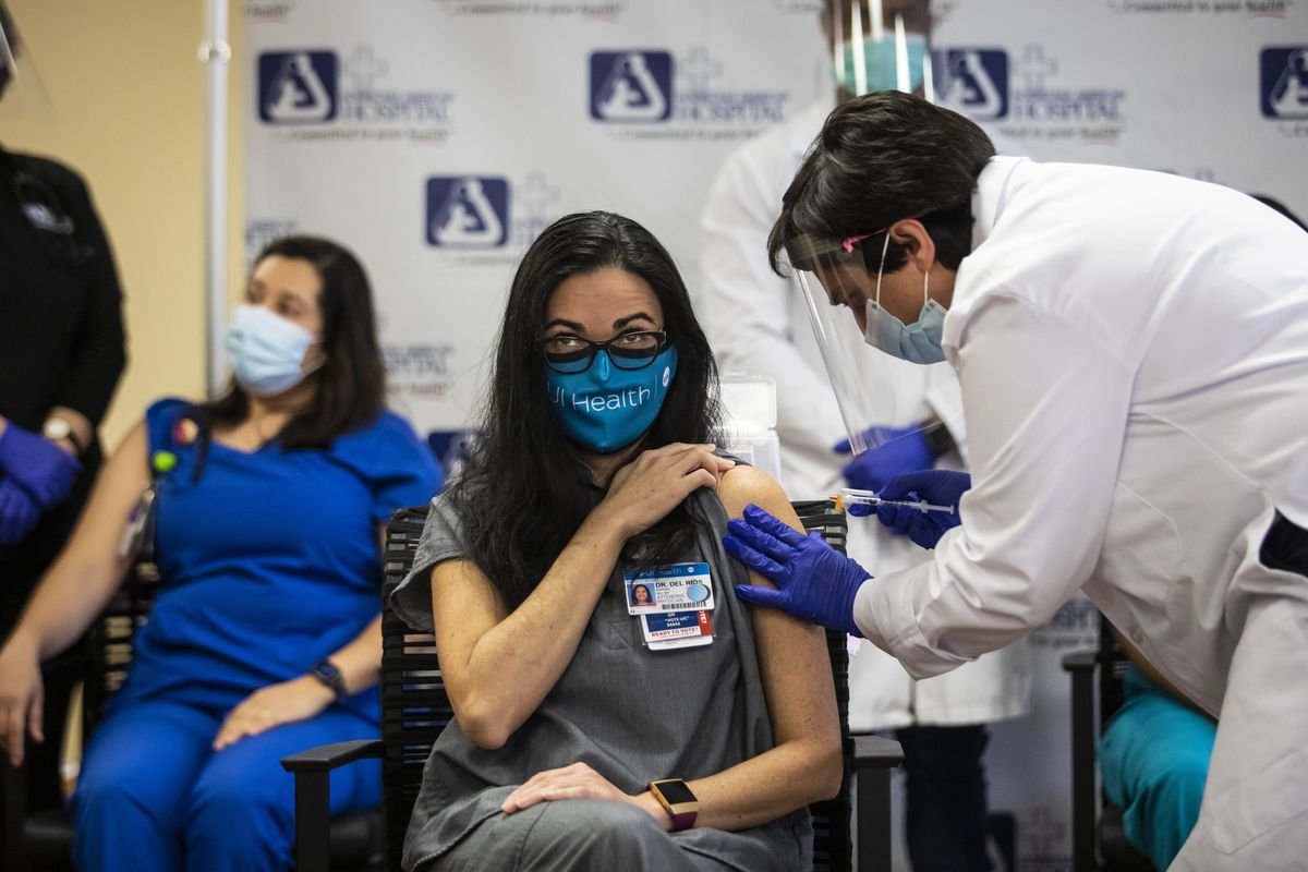 Dr. Marina Del Rios, from University of Illinois Hospital & Health Sciences System, gets her second and final dose of the COVID-19 vaccine at Norwegian American Hospital on the West Side earlier this month.