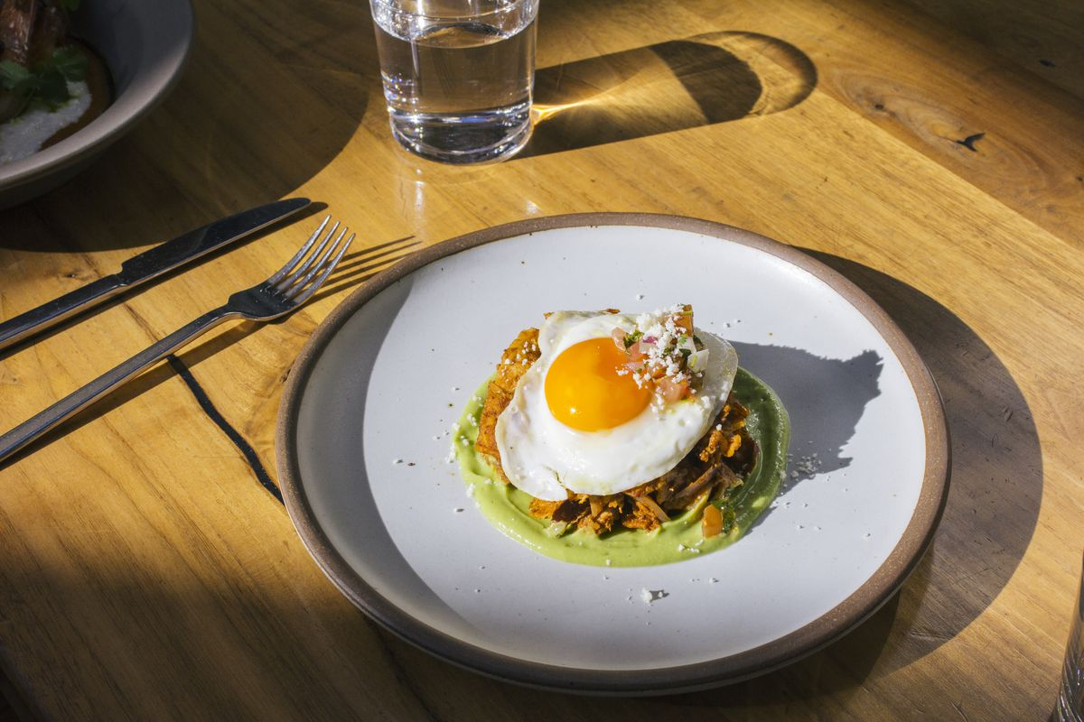 Redbird's duck confit chilaquiles in Downtown Los Angeles, California.
