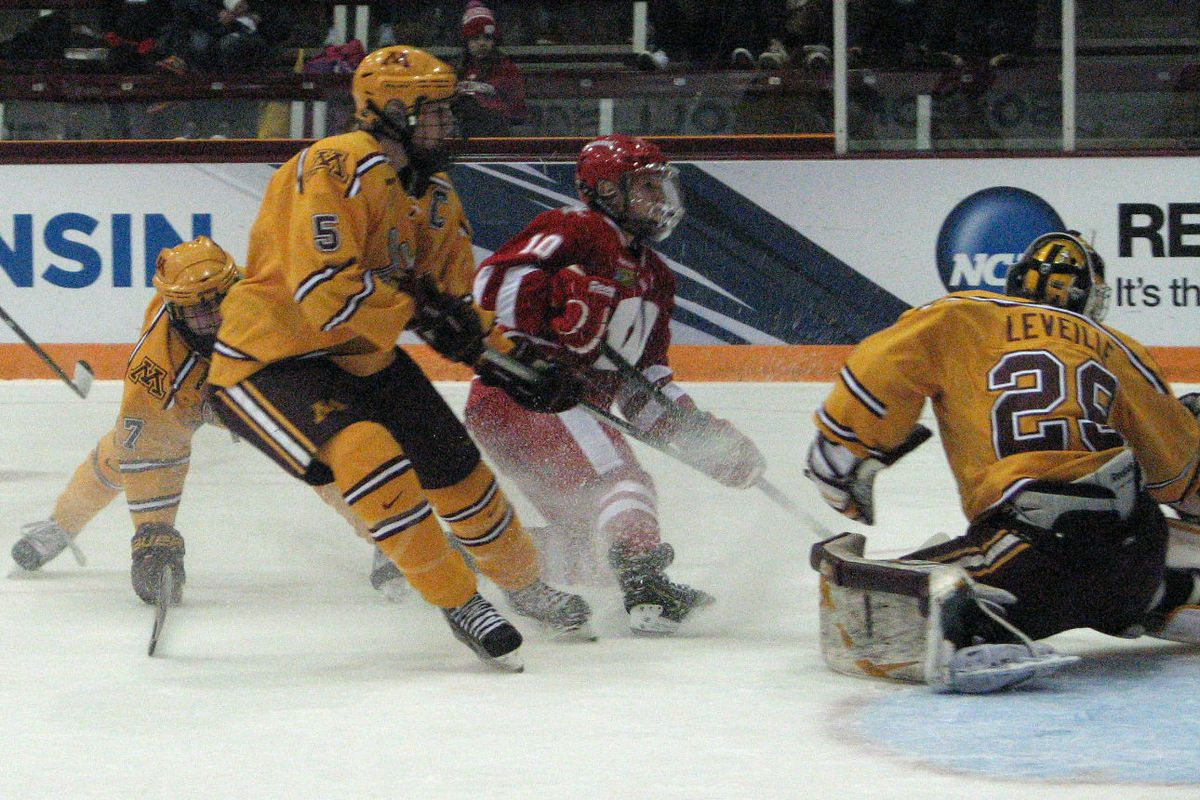 Brittany Ammerman (10 in red) and the Badgers threw 35 shots at Amanda Leveille, but she and the Gophers defense stood tall in a 3-1 win Friday to head to the Frozen Four championship