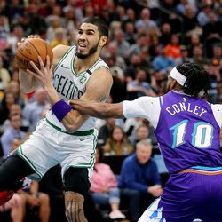 Boston Celtics forward Jayson Tatum (0) is fouled by Utah Jazz guard Mike Conley (10) on a drive to the hoop as the Utah Jazz and the Boston Celtics play an NBA basketball game at Vivint Arena in Salt Lake City on Wednesday, Feb. 26, 2020.