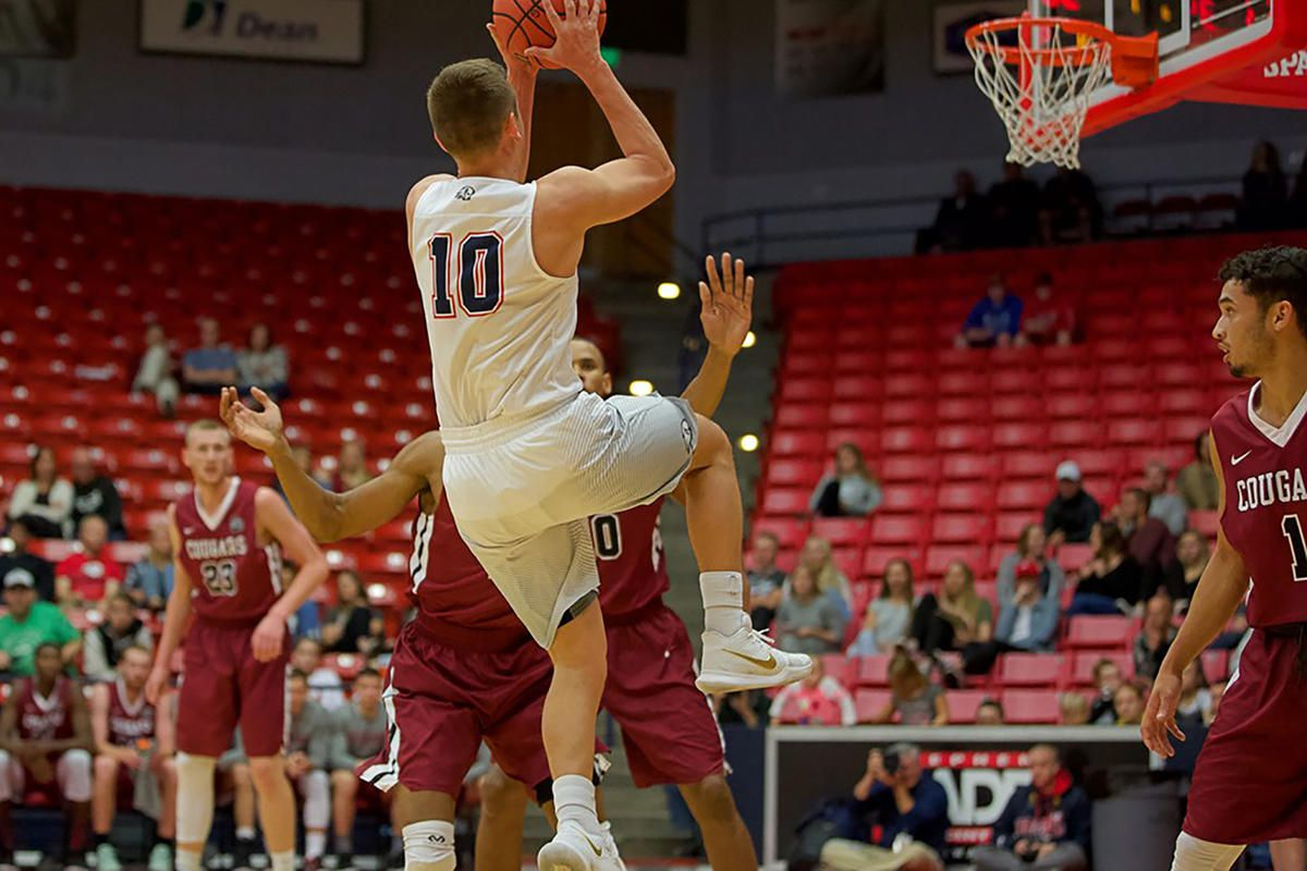 Dixie State senior guard Brandon Simister (10) rises for two of his team-high 19 points in the Trailblazers' 88-73 victory over Azusa Pacific Saturday afternoon in St. George.
