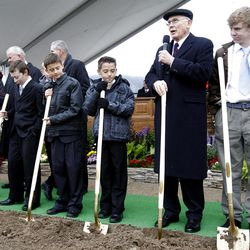 Elder Dallin H. Oaks stands with 12 year old deacons from the Payson area who he invited to come up and take part in the ceremony as thousands turn out in the rain Saturday, Oct. 8, 2011 for the ground breaking for the Payson Temple.