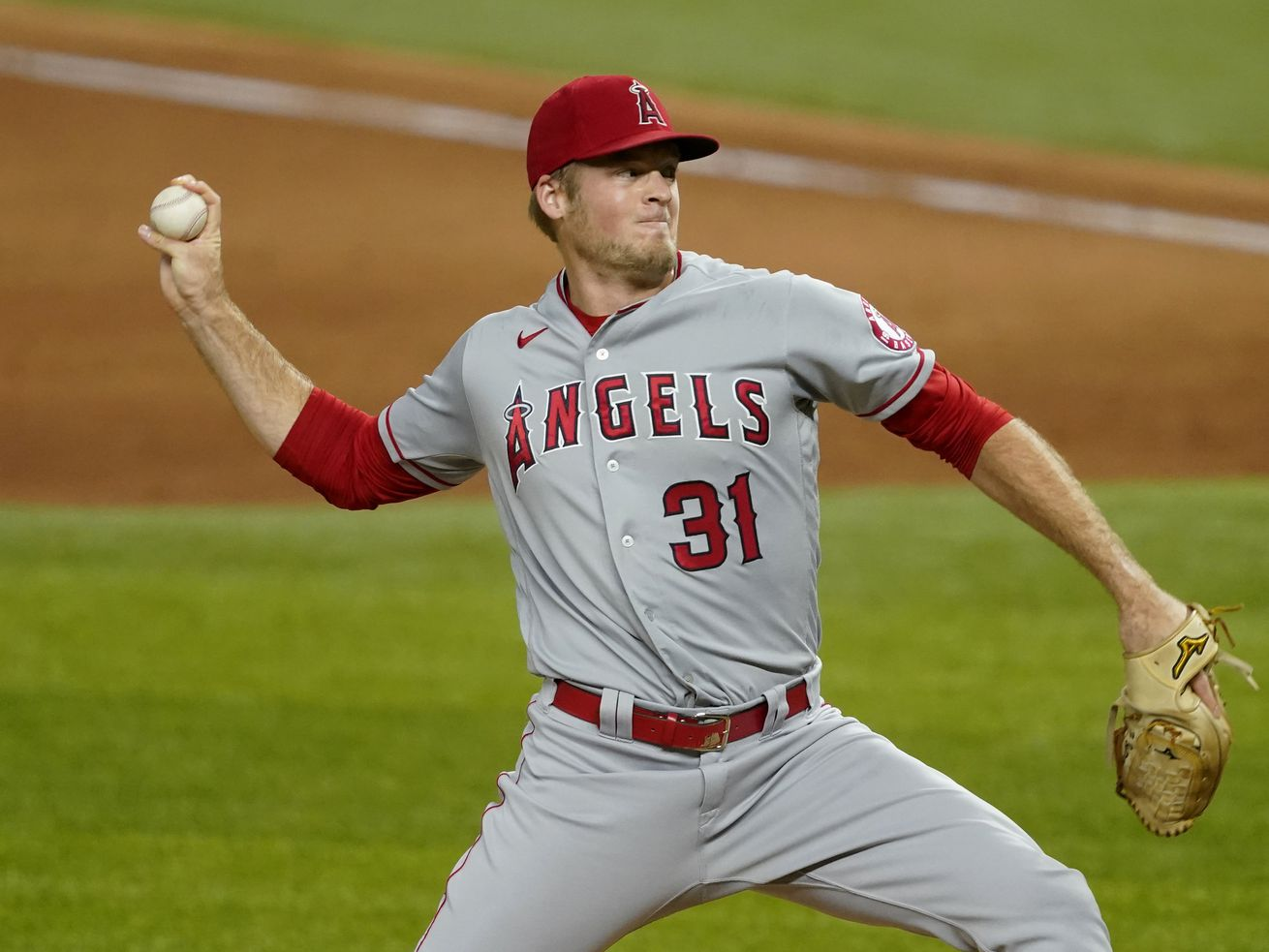 In this Sept. 10, 2020, file photo, Los Angeles Angels relief pitcher Ty Buttrey throws to a Texas Rangers batter during the ninth inning of a baseball game in Arlington, Texas. Buttrey has retired from baseball, saying he has lost his affection for the game.