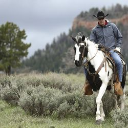 FILE - U.S. Interior Secretary Ryan Zinke takes a horseback ride in the Bears Ears National Monument with local and state representatives on Tuesday, May 9, 2017. Zinke released an executive summary of his findings from a 120-day review of 27 national monuments. The report says some monument designations clearly stretched definitions in the 1906 Antiquities Law, but it lacks specifics.