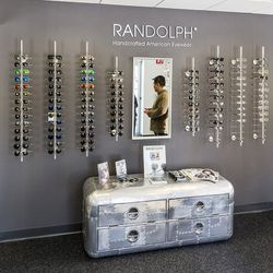 A small but effective retail display greets visitors upon walking into the office. More than a dozen styles are available to try on, as well as the brand's optical line and shooting collection.