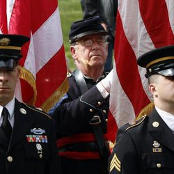 A man in a Civil War union uniform is flanked by two soldiers  during the military funeral for Civil War veteran Peter Knapp at Willamette National Cemetery in Portland, Ore., Friday, April 13, 2012. Knapp is the first Civil War veteran buried at Willamette National Cemetery, Oregon's largest veterans' cemetery. His ashes had been sitting on a shelf at the Portland Crematorium since 1924.
