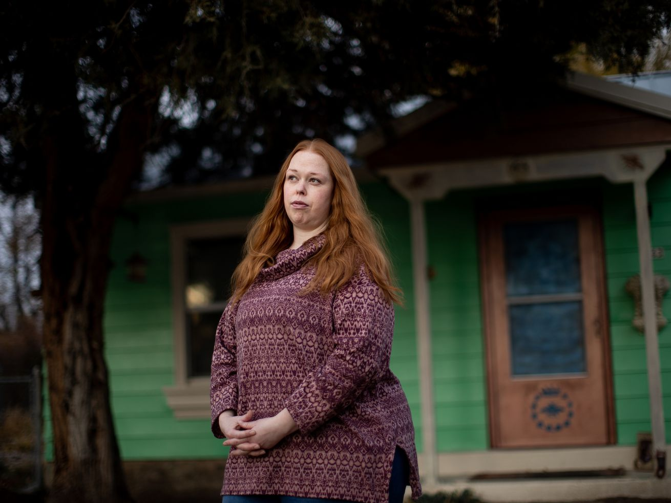 Katie Wood poses for a photograph outside of her home in Layton on Tuesday, Nov. 17, 2020. Wood's 70-year-old father, Tom Black, is an inmate at the Utah State Prison and has contracted COVID-19.