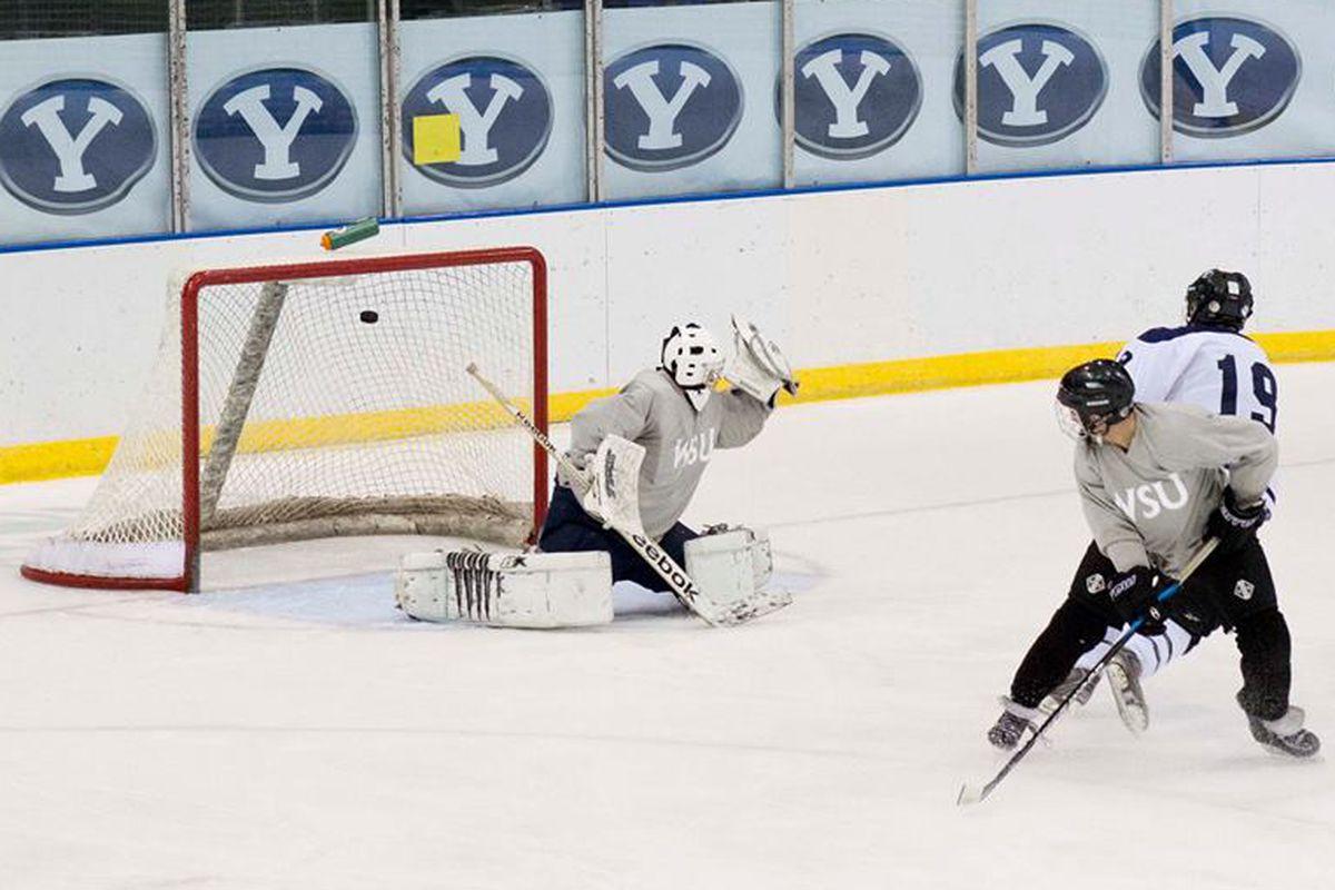 BYU's Nick Bartholomew beats Weber State goaltender Lucas Thatcher at the Peaks Ice Arena