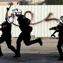 Riot police throw stun grenades and fire tear gas as they run after Bahraini anti-government protesters during clashes with riot police in Sadad, Bahrain, on Saturday, Sept. 29, 2012, after the politically charged funeral for Ali Hussein Niema, 17, who allegedly was shot dead by riot police late Friday. The death could bring fresh protests by Shiite-led groups seeking a greater political voice in the Sunni-ruled Gulf kingdom.