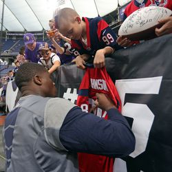 Aug 9, 2013; Minneapolis, MN, USA; Houston Texans wide receiver Andre Johnson (80) signs autographs for fans before a game against the Minnesota Vikings at the Metrodome.