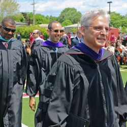 Supreme Court nominee Merrick Garland marches into Niles West's commencement ceremony Sunday in Skokie.   Tim Boyle/For the Sun-Times