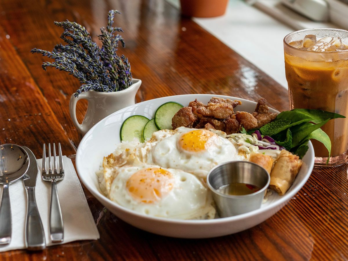 plate with eggs and egg rolls and iced coffee