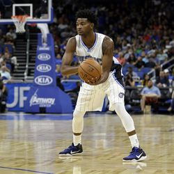 Orlando Magic's C.J. Wilcox looks to pass the ball against the San Antonio Spurs during the first half of an NBA preseason basketball game, Wednesday, Oct. 12, 2016, in Orlando, Fla. (AP Photo/John Raoux)