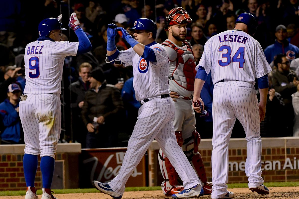 May 2, 2017; Chicago, IL, USA; Chicago Cubs left fielder Kyle Schwarber (12) celebrates with second baseman Javier Baez (9) after they scored on his three run home run in the fourth inning against the Philadelphia Phillies at Wrigley Field. Mandatory Credit: Matt Marton-USA TODAY Sports