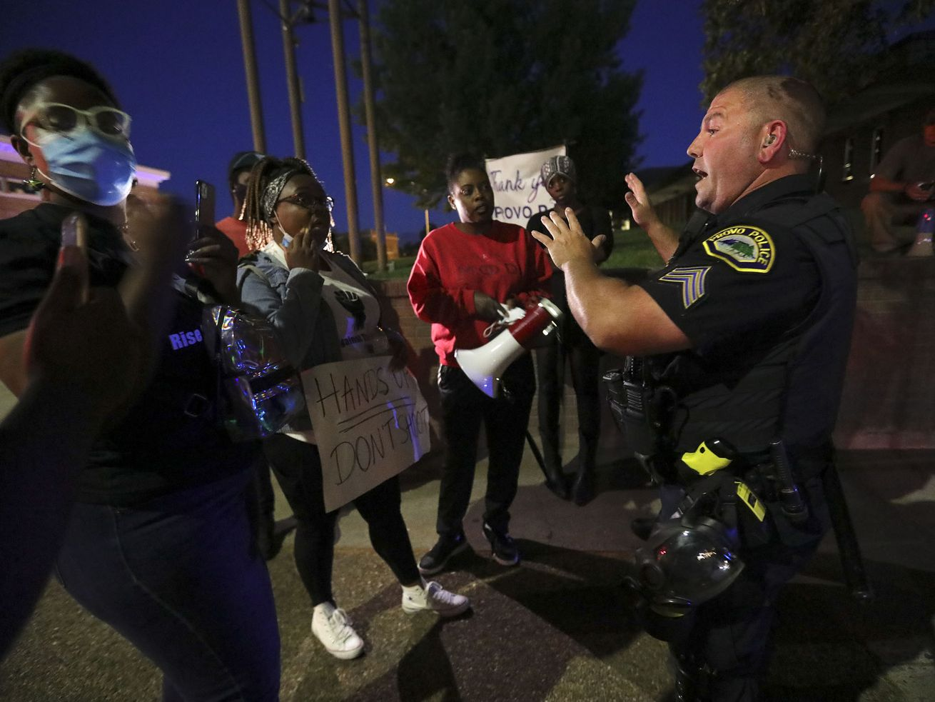 Provo Police Sgt. Palmer talks to protesters during a rally against police brutality and racism outside of the Provo Police Department in Provo on Monday, June 29, 2020.