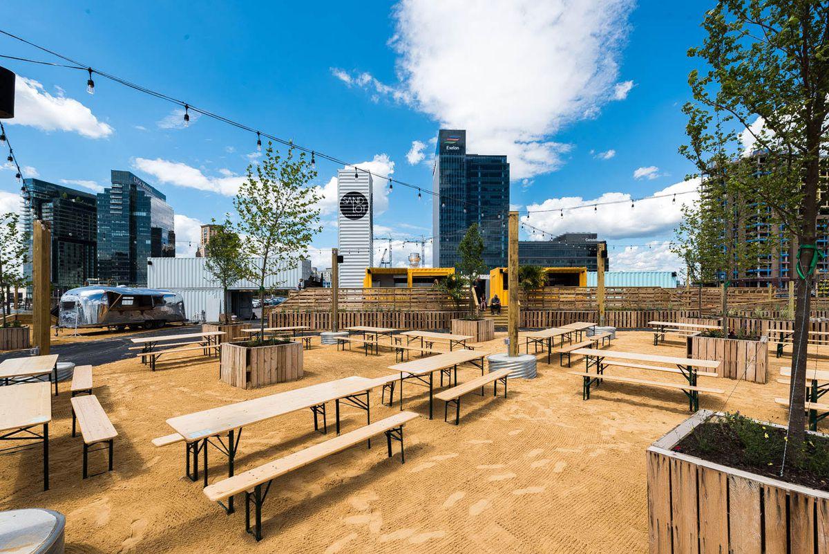 Sandlot, the temporary restaurant/beach bar Spike Gjerde's installed in Baltimore's Inner Harbor, officially opens June 15.