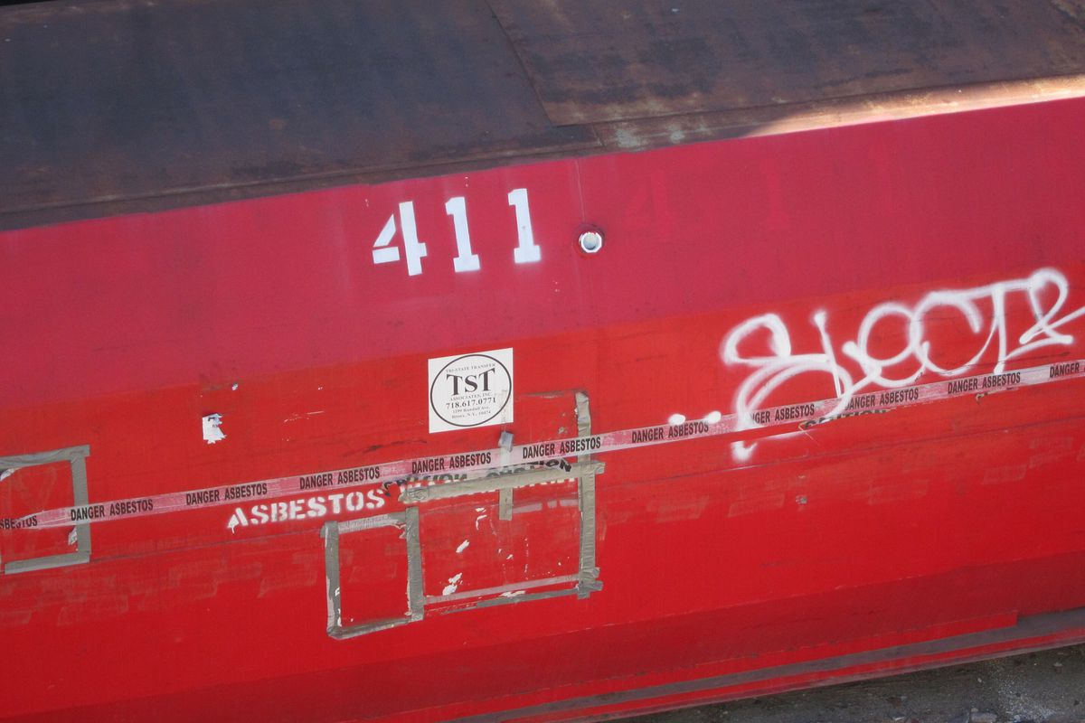 A red container used for asbestos abatement sat on a Prospect Lefferts Gardens lot on Bedford Avenue in October 2020.