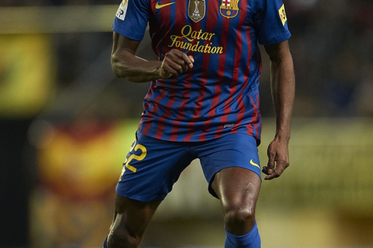VILLARREAL, SPAIN - JANUARY 28: Eric Abidal of Barcelona in action during the la Liga match between Villarreal and Barcelona at El Madrigal on January 28, 2012 in Villarreal, Spain.  (Photo by Manuel Queimadelos Alonso/Getty Images)