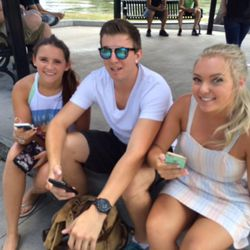 Amy deMik, 21, Salt Lake City, left, Andrew Martin, 23, Murray, and Brittney Kiholm, 20, right, play Pokemon Go at Liberty Park Sunday afternoon.