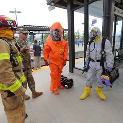 """Emergency personnel participate in""""Hell on Wheels,"""" a full-scale, two-day, emergency protection and response drill at the Salt Lake Central Station on Tuesday, Aug. 8, 2017. The drill included emergency personnel from the Utah Transit Authority, the FBI, Salt Lake County Emergency Management, the West Valley and Salt Lake City fire departments, University of Utah Emergency Management, the University of Utah Police Department, Amtrak, Union Pacific, Murray Victim Advocates and Utah State Medical Examiner's Office. The drill simulated multiple terrorists entering the Salt Lake Valley and dividing up."""