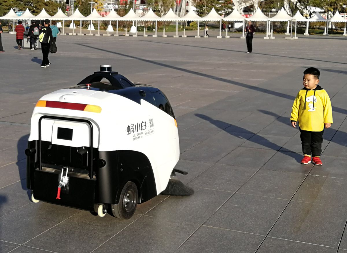 Self-Driving Sweeper And Autonomous Driving Retail On Duty In Beijing
