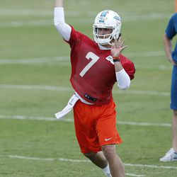 DAVIE, FL - MAY 23: Clint Chelf #7 of the Miami Dolphins throws the ball during the rookie minicamp on May 23, 2014 at the Miami Dolphins training facility in Davie, Florida.