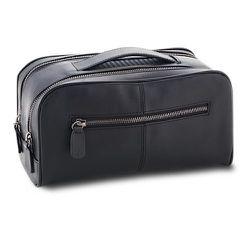 """<strong>The Art of Shaving</strong> Leather Dopp Kit in Black, <a href=""""http://www.theartofshaving.com/DOPP-Kit/00670535900573,default,pd.html?start=4&cgid=travel-leather-goods&navid=travel-leather-goods"""">$135</a>"""