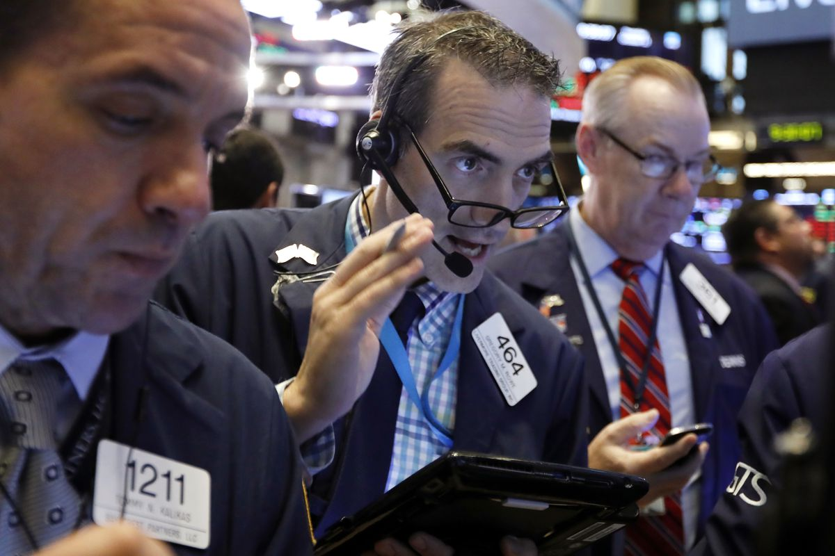 Gregory Rowe, center, works with fellow traders on the floor of the New York Stock Exchange, Thursday, Oct. 11, 2018. The market's recent decline was set off by a sharp drop in bond prices and a corresponding increase in yields last week and early this we
