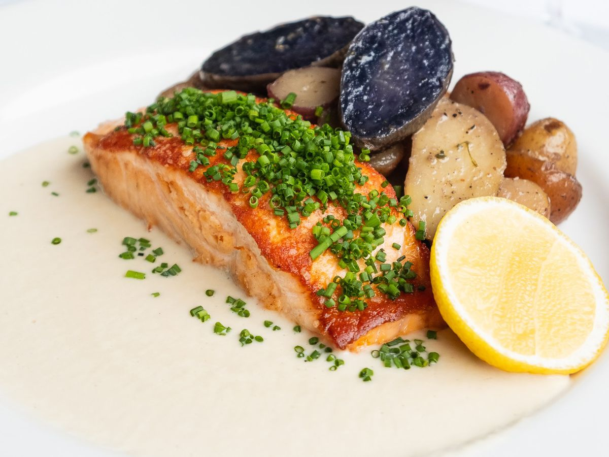 Seared salmon with confit potatoes and soubise sauce