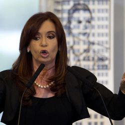 Argentina's President Cristina Fernandez announces a bill to nationalize Spain's controlled oil company YPF, at Government House in Buenos Aires, Argentina, Monday April 16, 2012. Fernandez said in an address to the country that the measure sent to congress on Monday is aimed at recovering the nation's sovereignty over its hydrocarbon resources. Behind Fernandez is a scale model of an iron sculpture of Argentina's former first lady and second wife of late President Juan Peron, Eva Peron.